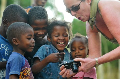 Opus Partner, Annie de Cossy, shares in the delight of the kids seeing themselves on the camera. (photo credit: Terry Sebastian)
